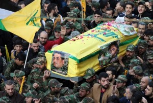 Members of Lebanon's militant Shiite Muslim movement Hezbollah carry the coffin of Lebanese militant Samir Kantar, who was killed in a suspected Israeli air-raid on his home in the Jaramana district on the outskirts of the Syrian capital Damascus, during his funeral procession in a southern suburb of the Lebanese capital Beirut on December 21, 2015. Israel's justice minister welcomed the death of Kantar but did not claim credit for the air strike in Syria that killed him, which Hezbollah said was an Israeli raid. AFP PHOTO / ANWAR AMRO / AFP / ANWAR AMRO